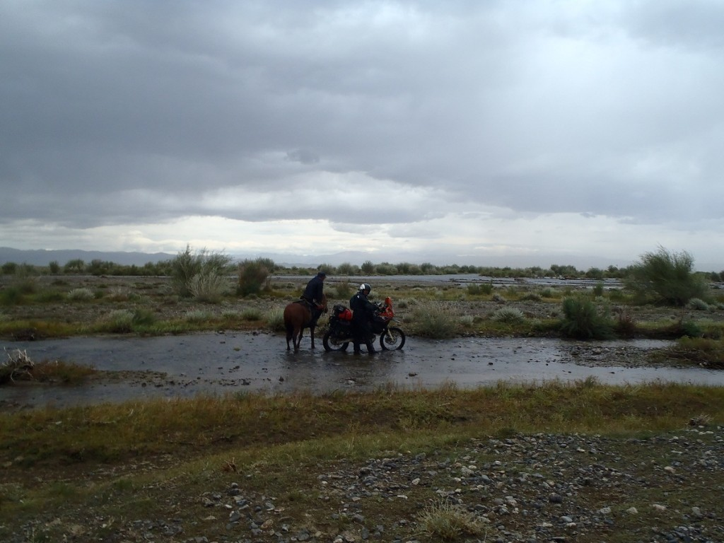 Mongolian river crossing with horseman.
