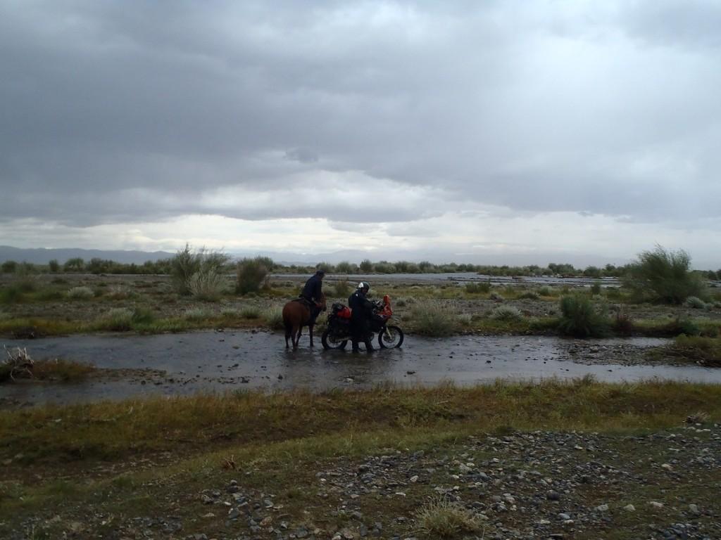 Mongolian river crossing with horseman.